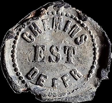 Plomb de scellé ouvert à la lecture et aux identifications (Compagnie des chemins de fer de l'Est).