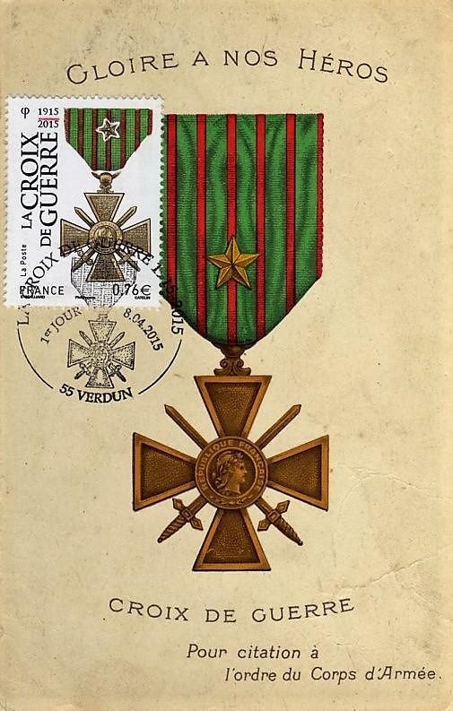 Une croix de guerre pour citation à l'ordre du corps d'armée se distingue par une étoile vermeil.